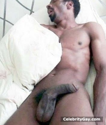 MATURE LADY SPREADING SHAVED PUSSY